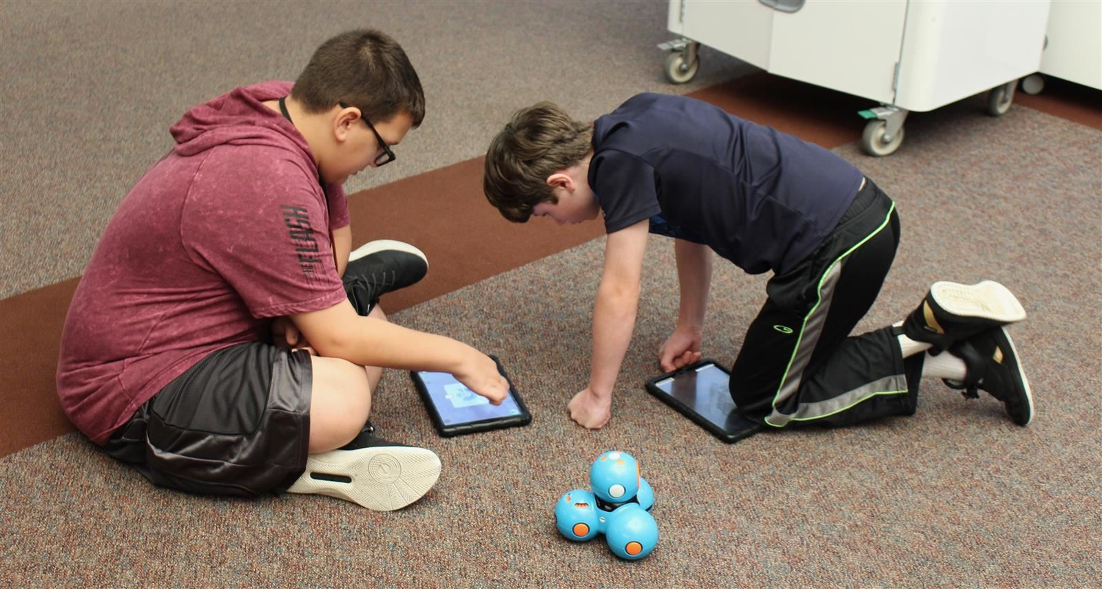 Students coding Dash robot