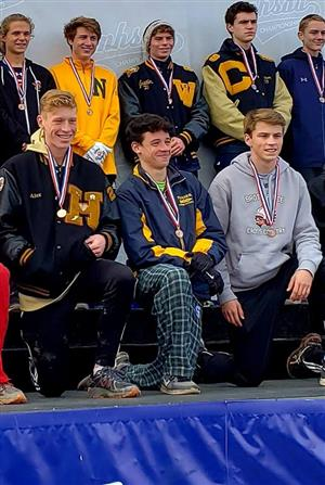 Joey Tavalieri at State winning medal.