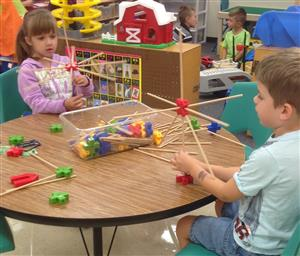 Children building models