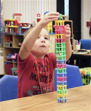 student building a tower